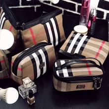化妆包2017新款韩国旅行收纳包女士大容量洗漱女包防水布零钱包袋