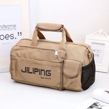 短途旅行包男女手提旅行袋行李包圆筒运动包健身包帆布训练包 新款