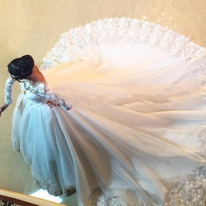 穆斯林回族高档蕾丝长袖长拖尾a字唯美新娘婚纱2017新款时尚婚纱图片